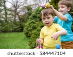Kids On Easter Egg Hunt In...