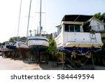 fishing boats and sailboats at... | Shutterstock . vector #584449594