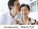 mother and adult son together ... | Shutterstock . vector #584451700