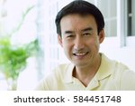 portrait of a man  smiling | Shutterstock . vector #584451748