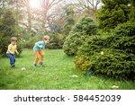 kids on easter egg hunt in... | Shutterstock . vector #584452039