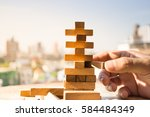 the tower from wooden blocks... | Shutterstock . vector #584484349