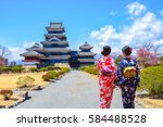 two geishas wearing traditional ...   Shutterstock . vector #584488528