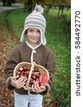 young boy with woolen hat is... | Shutterstock . vector #584492770