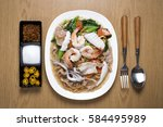 crispy noodles in creamy sauce... | Shutterstock . vector #584495989