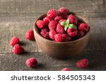 ripe fresh sweet raspberries in ... | Shutterstock . vector #584505343