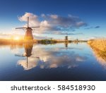 Windmills At Sunrise. Rustic...