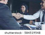 businessmen handshake after... | Shutterstock . vector #584519548