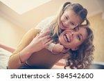 mother and daughter spending... | Shutterstock . vector #584542600