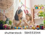 mother and her daughter... | Shutterstock . vector #584553544