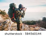 man traveler photographer with... | Shutterstock . vector #584560144