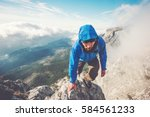 man traveler climbing on... | Shutterstock . vector #584561233