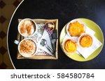 pasteis de nata and a... | Shutterstock . vector #584580784