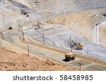 Giant Water Truck Keeps Dust Down at Copper Mine - stock photo