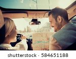 smiling man and woman using map ... | Shutterstock . vector #584651188