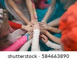 Small photo of Children holding hands. Community. Game. All together.