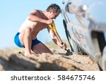 Man Digs A Car Stuck In The...