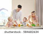 happy family having breakfast... | Shutterstock . vector #584682634