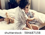 mother hug and consoling the... | Shutterstock . vector #584687158