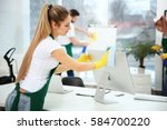 young female worker cleaning... | Shutterstock . vector #584700220