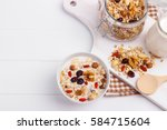 bowl of homemade muesli with... | Shutterstock . vector #584715604