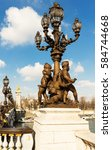 Small photo of Baroque bronze lantern with Cupids on the bridge of Alexander III in Paris, France