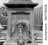 Small photo of Vintage water fountain in Mulhouse, France Place de la reunion with French inscription Eau potable translating as Drinking Water