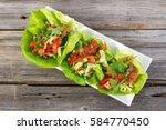 mexican pork lettuce wraps as... | Shutterstock . vector #584770450