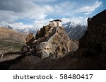 A watchtower at the old monastery in Dhankar is set against a Himalayan backdrop. - stock photo