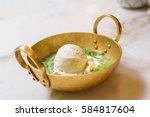 coconut milk ice cream on brass ... | Shutterstock . vector #584817604