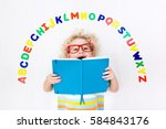 happy preschool child learning... | Shutterstock . vector #584843176