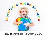 happy preschool child learning... | Shutterstock . vector #584843230
