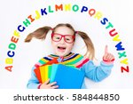 happy preschool child learning... | Shutterstock . vector #584844850