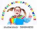 happy preschool child learning... | Shutterstock . vector #584844850