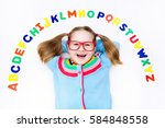 happy preschool child learning... | Shutterstock . vector #584848558