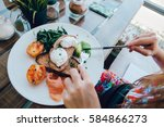 poached eggs benedict served on ... | Shutterstock . vector #584866273