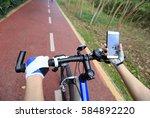 cyclist hands use gps navigator ... | Shutterstock . vector #584892220