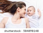 happy young mother playing with ... | Shutterstock . vector #584898148