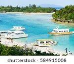 glass boats at kabira bay... | Shutterstock . vector #584915008