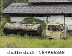 Small photo of The old oil truck or tanker was left abandoned in the grass at the afterbirth