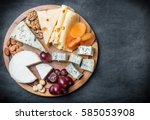 assorted cheeses  nuts and... | Shutterstock . vector #585053908