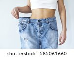 weight loss woman with jean on... | Shutterstock . vector #585061660