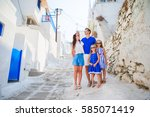 happy family of four in greece | Shutterstock . vector #585071419