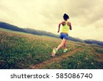 young fitness woman trail... | Shutterstock . vector #585086740