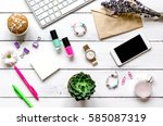 female wooden desktop with... | Shutterstock . vector #585087319
