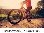 young woman cyclist riding... | Shutterstock . vector #585091108