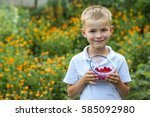 Cute Little Boy Holding Bowl...
