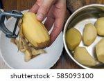 detail of woman hands peeling... | Shutterstock . vector #585093100