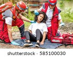 rescue team helping injured... | Shutterstock . vector #585100030