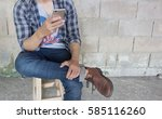 vintage  a man wearing a plaid... | Shutterstock . vector #585116260